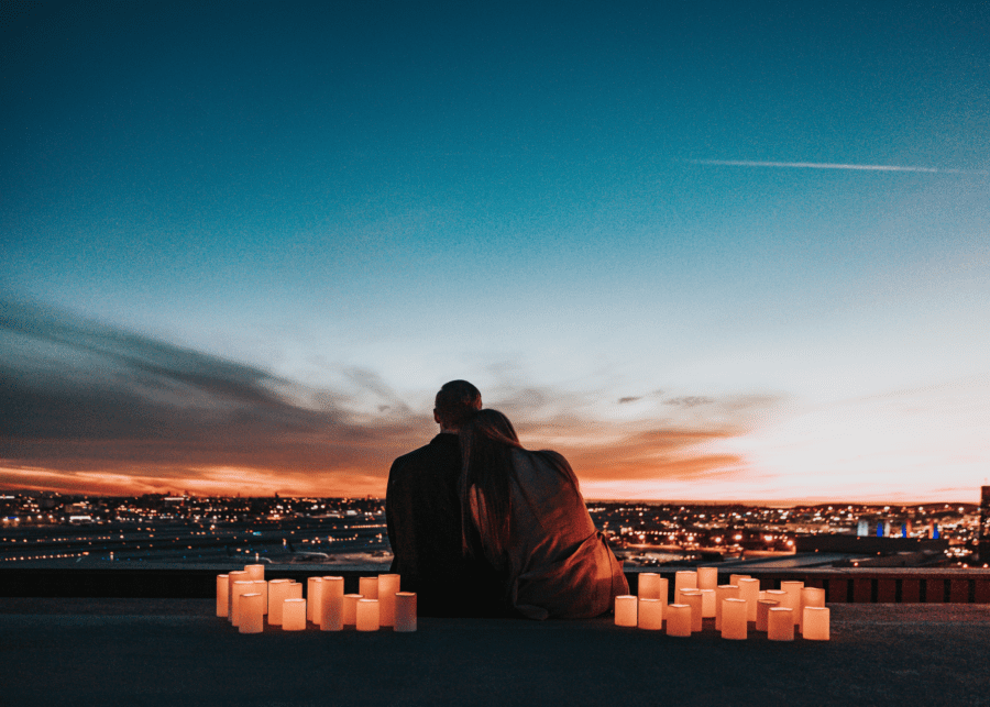 couple with city lights | dating apps