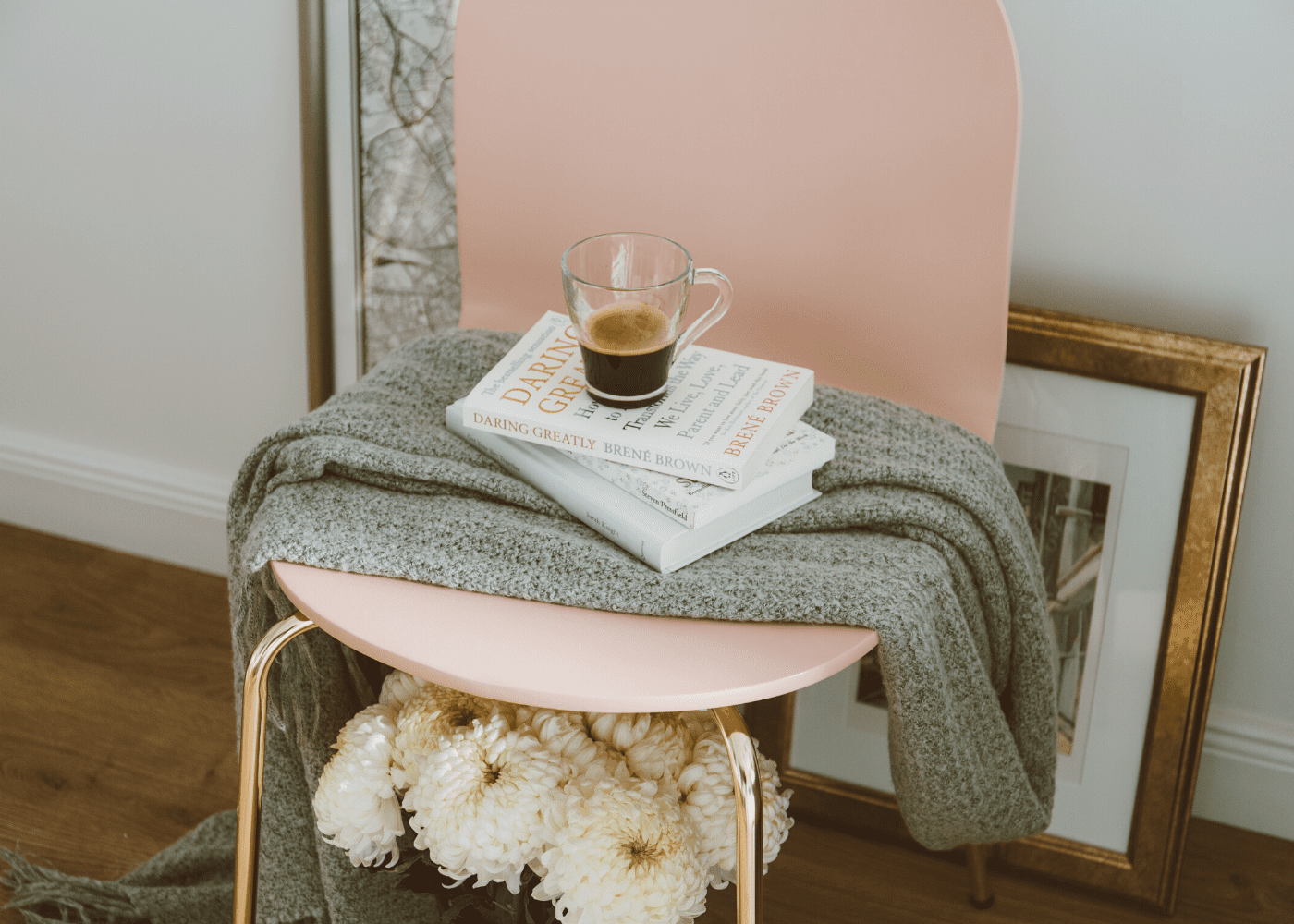 books on a chair with flowers