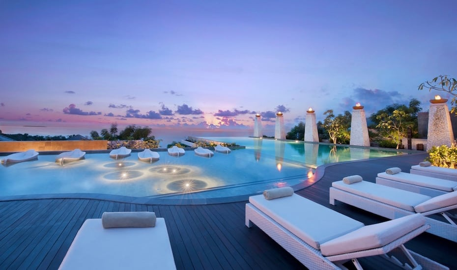 Clifftop infinity pool at sunset at Banyan Tree Ungasan in Uluwatu, Bali - Indonesia