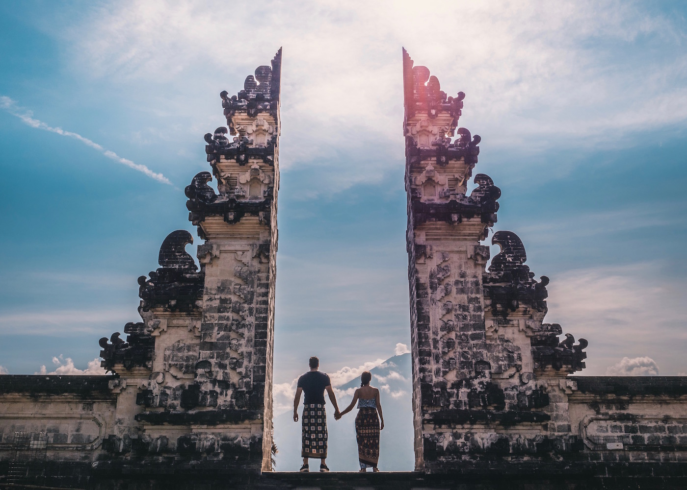 "Couple standing inside Pura Lempuyang temple AKA ""The Gateway to Heaven"" in Kerangasem, Bali, Indonesia"