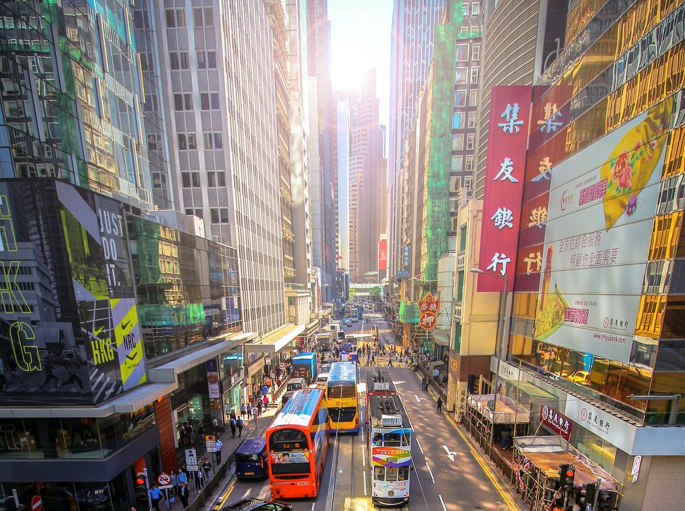 Hong Kong road aerial view with buildings, buses, and trams