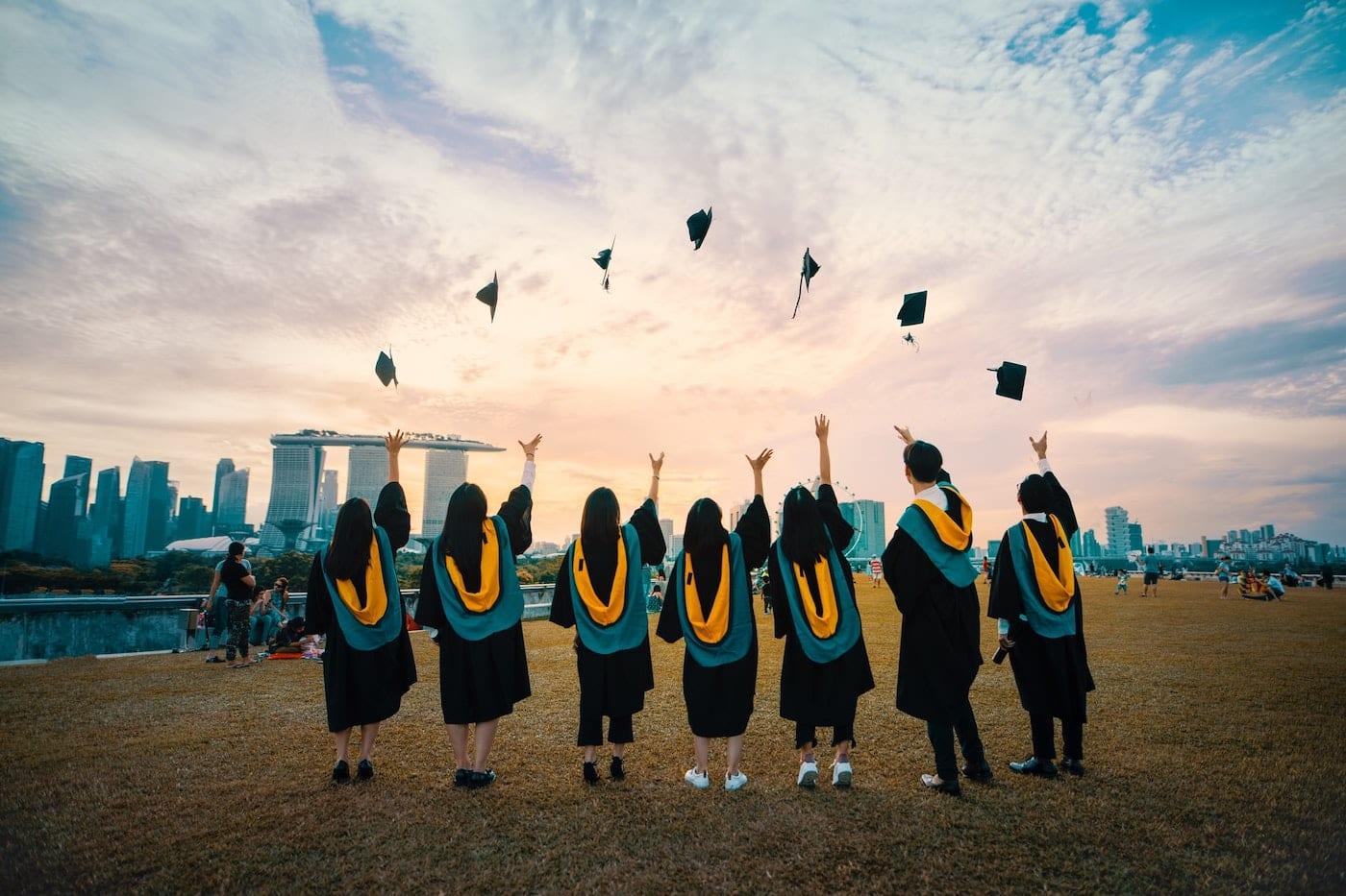 people throwing their graduation hat